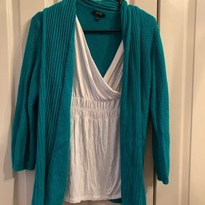 Layered look teal sweater with white blouse